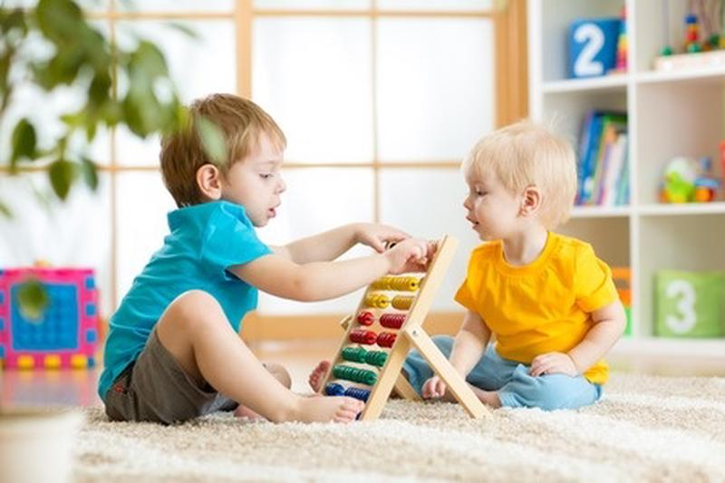 children playing with Chinese calculator